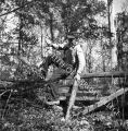 Pete Rakes climbs rail fence