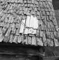 Repaired wood shingle roof
