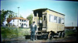 Unknown Man in front of a Yellow Railroad car