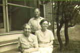 [Pastor with his wife and mother on his porch]