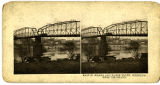 Stereoview card of Main St. Bridge and Water front; Wheeling from the island